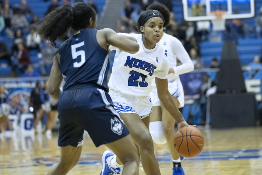 Memphis guard Jamirah Shutes (23) drives defended by Connecticut guard Christyn Williams (5) in the first half of an NCAA college basketball game Tuesday, Jan. 14, 2020, in Memphis, Tenn. (AP Photo/Nikki Boertman)