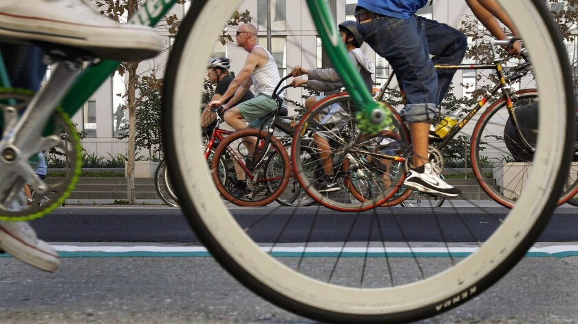 Bicyclists have an L.A. street to themselves during a CicLAvia event -- a far different scenario from what the city's bicycle commuters face.