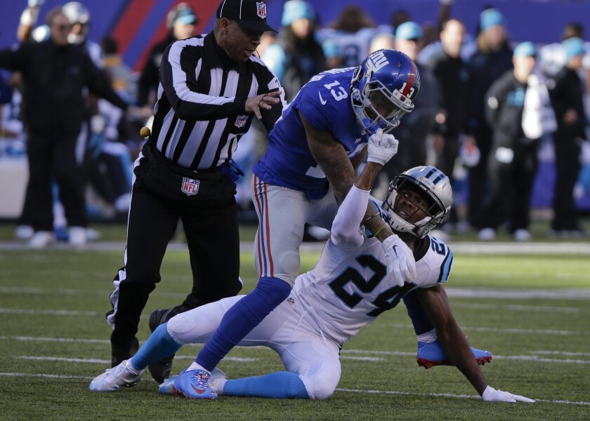 Josh Norman, right, and Odell Beckham Jr. scuffle during Sunday's game between the Carolina Panthers and the New York Giants.