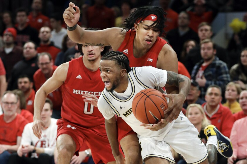 Michigan's Zavier Simpson (3) drives past Rutgers's Daniel Lobach (2) during the second half of an NCAA college basketball game Saturday, Feb. 1, 2020, in New York. Michigan won 69-63. (AP Photo/Frank Franklin II)