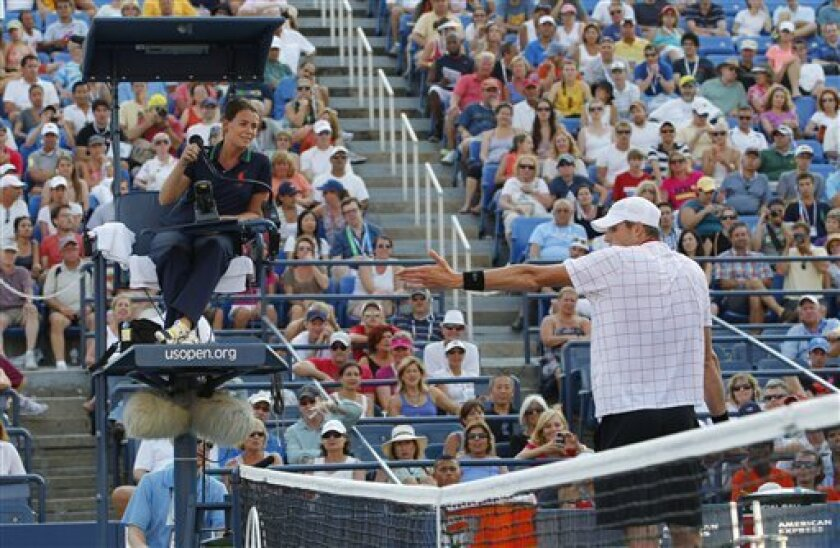 John Isner argues a call during his match against Jarkko Nieminen, of Finland, in the third round of play at the 2012 US Open tennis tournament, Friday, Aug. 31, 2012, in New York. (AP Photo/Paul Bereswill)