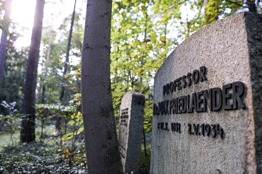 This Oct. 12, 2021 taken photo shows the grave of Max Friedlaender, a musicologist of Jewish faith at the Suedwestkirchhof Stahnsdorf, Germany. The German government's top official against antisemitism on Wednesday criticized the burial of a Holocaust denier on the former gravesite of a known Jewish musicologist. (Jens Kalaene/dpa via AP)