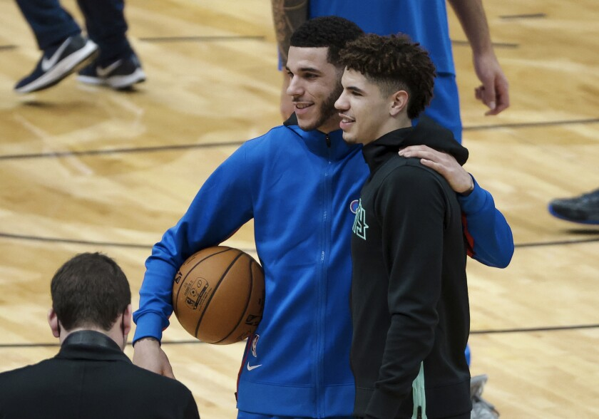 Lonzo, and LaMelo Ball pose for a photo before their first NBA game playing each other other on Jan. 7, 2020.