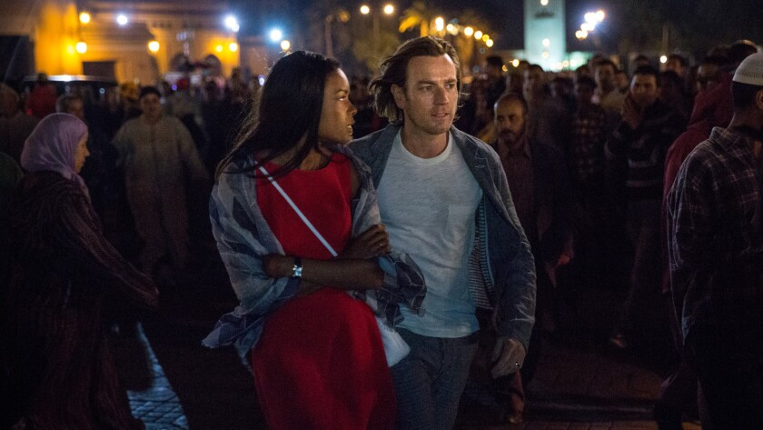 """Naomie Harris and Ewan McGregor in the movie """"Our Kind of Traitor."""""""