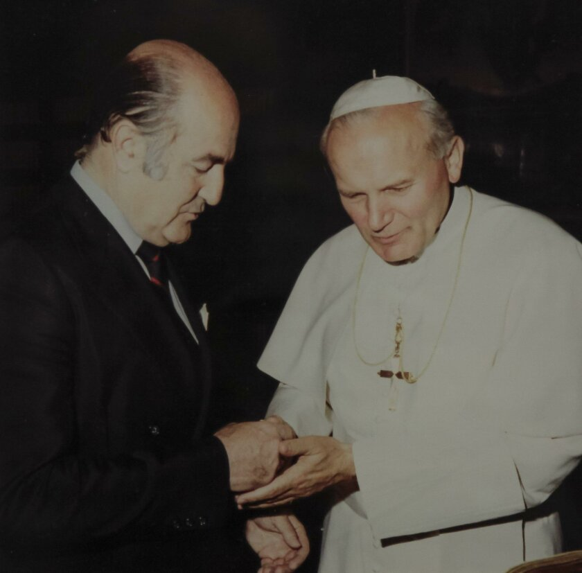 Ambassador Alejandro Orfila greets Pope John Paul II at a ceremony in 1982. Orfila said having the current pope, Francis, be from Argentina is the highest honor his native land could have.