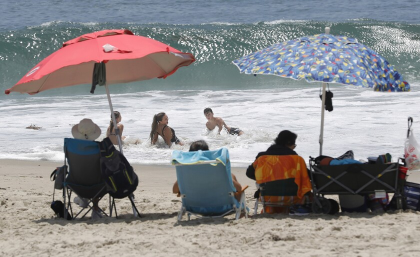 Beachgoers play