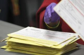 Voter database late, over budget