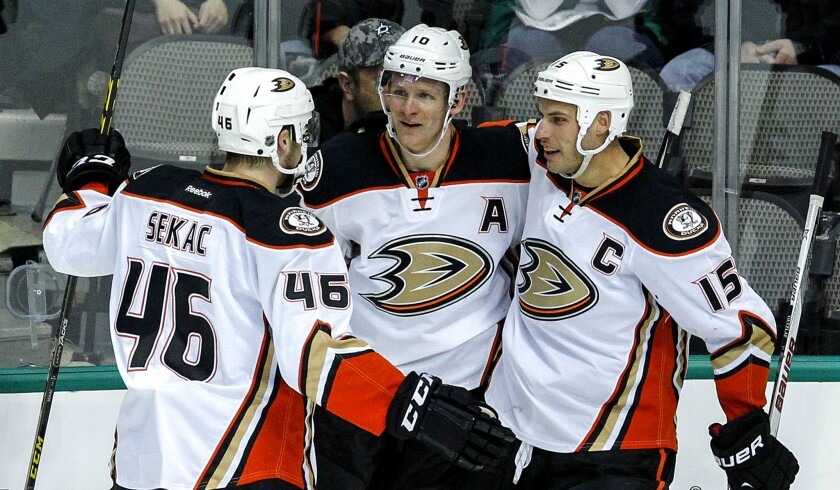 Ducks right wing Corey Perry (center) is congratulated by teammates Jiri Sekac and Ryan Getzlaf (15) after scoring against the Star in the first period Sunday in Dallas.