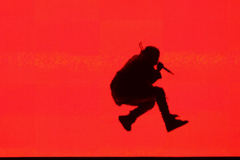 Kanye West is silhouetted onstage at the Made in America festival in downtown Los Angeles.