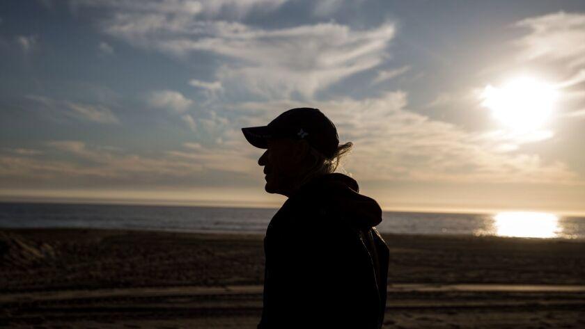 MALIBU, CA - NOVEMBER 15: Maurice Smith, who lives at a concession stand near Zuma beach, is silhoue