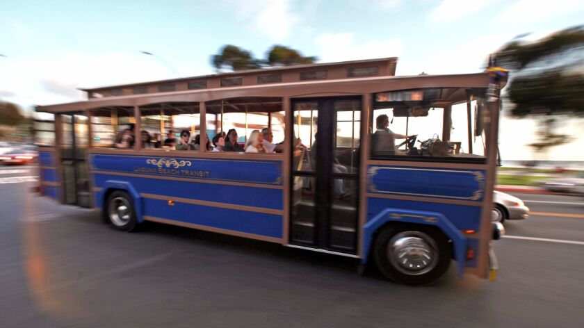 The Laguna Beach south route trolley roars past Forest Avenue after a day of moving riders around the city.