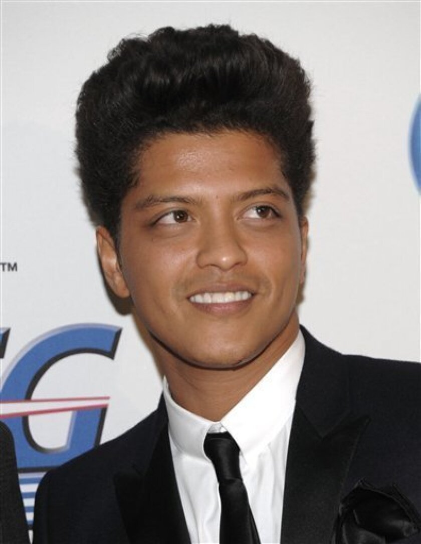Bruno Mars  arrives at the Pre-Grammy Gala & Salute to Industry Icons with Clive Davis honoring David Geffen on Saturday, Feb. 12, 2011 in Beverly Hills, Calif. (AP Photo/Dan Steinberg)