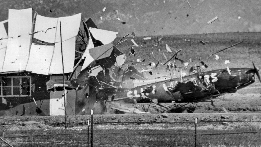May 5, 1962: Stunt pilot Cliff Winters flies his plane through a building during the National Air Circus at Riverside Grand Prix Racetrack. Winters climbed out of the wreckage unhurt.