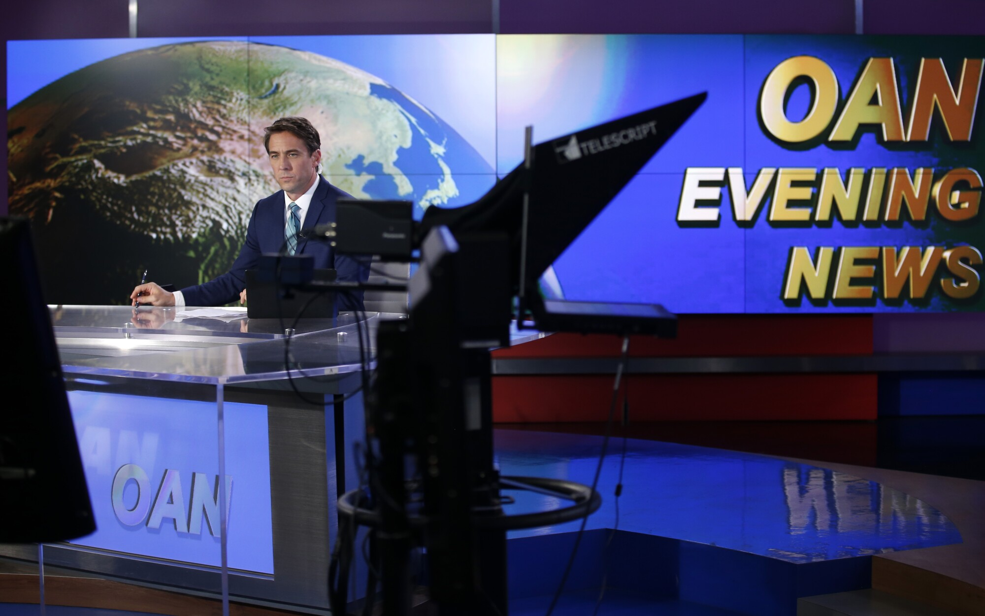 Patrick Hussion waits for a break while hosting an evening news segment at San Diego-based One America News on Sept. 5, 2019.
