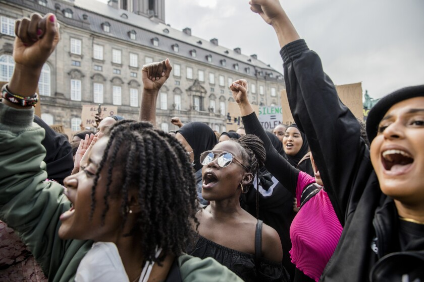 Demonstrators take part in an anti-racism demonstration in Copenhagen.
