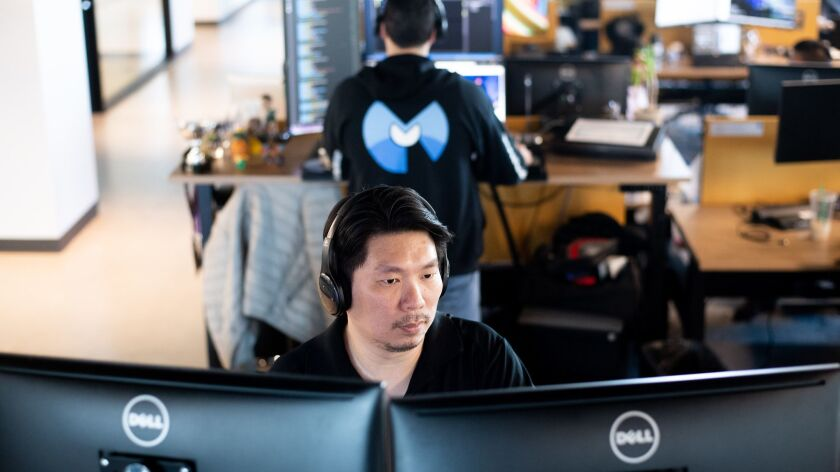 Malwarebytes quality assurance engineer Philip Lee takes a Udemy course at his desk on April 30 in Santa Clara, Calif.