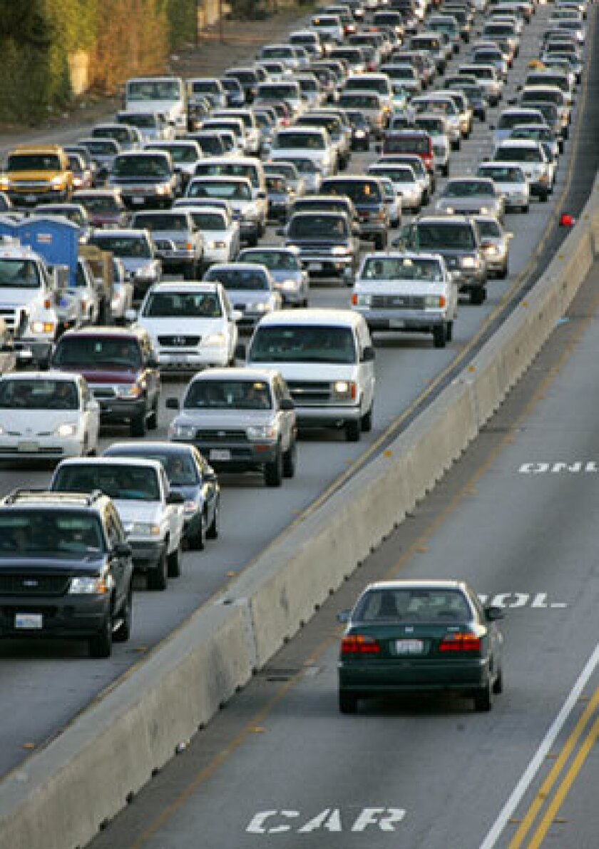 BARELY MOVING: Gridlock on the 405 is a familiar sight. County officials propose converting some carpool lanes to toll lanes, but the 405 is not included in the initial plan.