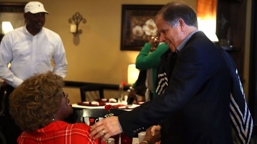 Alabama Senate Candidate Doug Jones Greets Diners On Day Before Election