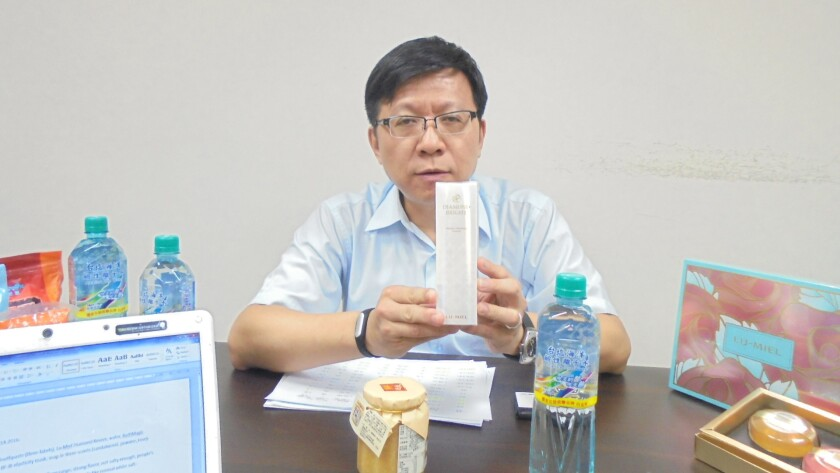 Taiyen Biotech Vice President Chen Shih-hui displays salt-based products.