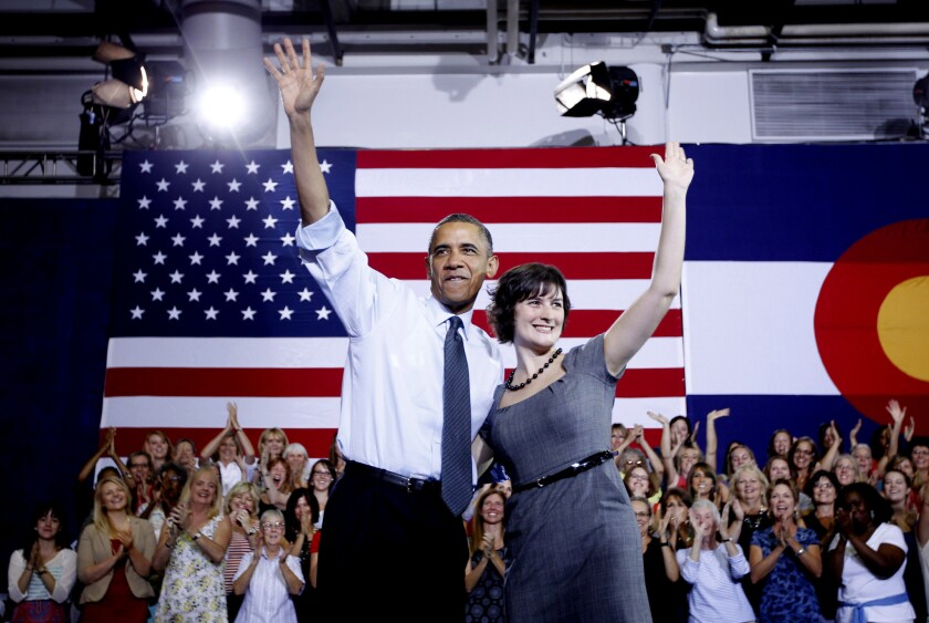 President Obama and Sandra Fluke wave at a campaign event at the University of Colorado in Aurora.