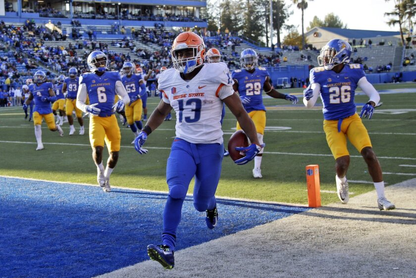 Boise State running back Jeremy McNichols (13) scores on a 19-yard run during the second half of an NCAA college football game against San Jose State, Friday, Nov. 27, 2015, in San Jose, Calif. (AP Photo/Marcio Jose Sanchez)