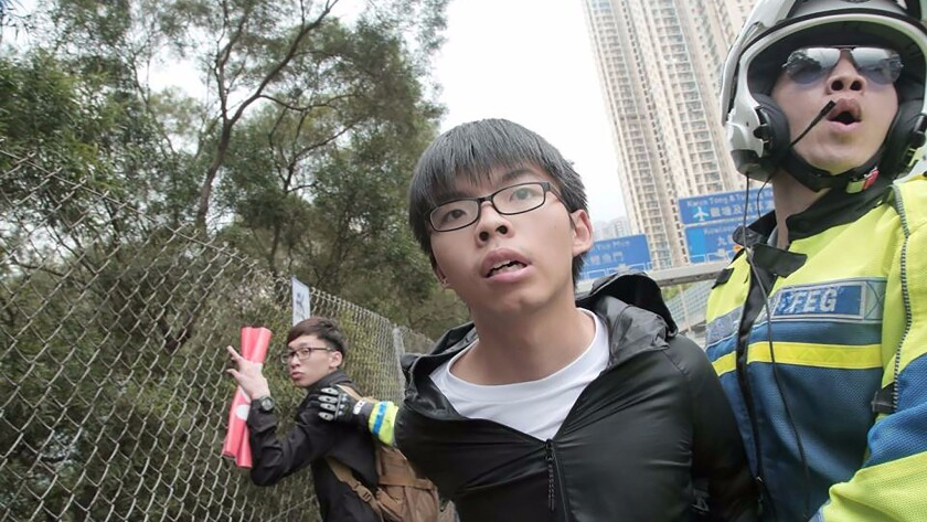 Democracy activist Joshua Wong was detained by Hong Kong police in May 2016.