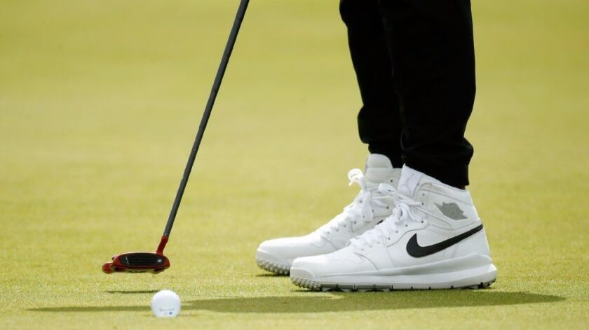 Jason Day wears Air Jordans as he putts on the 4th green July 20.
