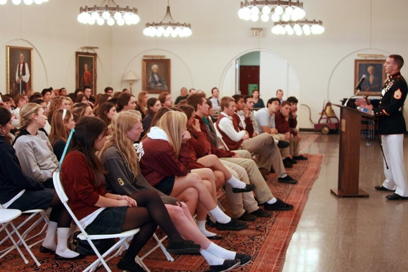 Bishops students pay rapt attention to Marine Staff Sgt. Mark Zambon, a double amputee who lost his legs while serving as an explosive ordnance disposal team leader.