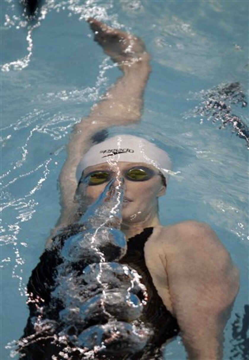 Missy Franklin glides under the water as she completes her turn on her way to winning the women's 100-meter backstroke at the Indianapolis Grand Prix swimming meet in Indianapolis, Saturday, March 31, 2012.  (AP Photo/Michael Conroy)
