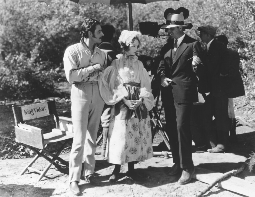 "John Gilbert, left, Lillian Gish and director King Vidor on the set of ""La Bohème."""