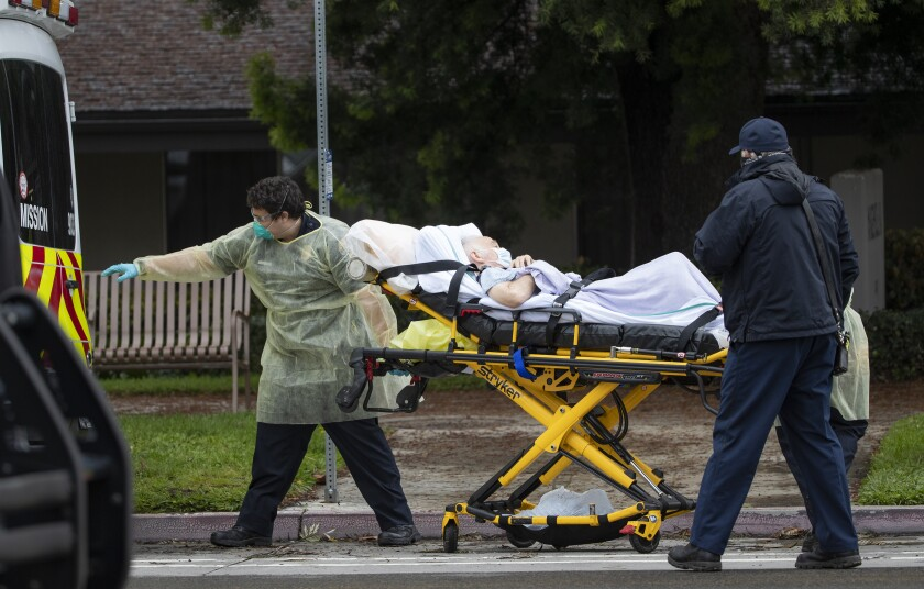 Paramedics load Bernie Erwig, 84, into an ambulance while he was removed from Magnolia Rehabilitation and Nursing Center.