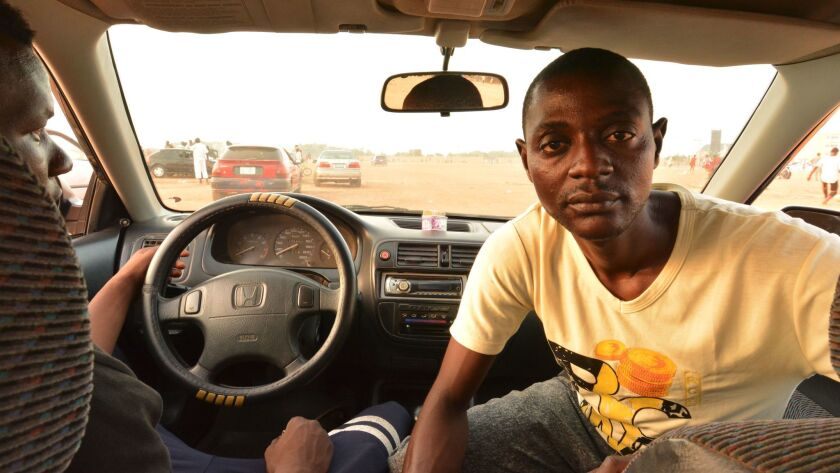 "Driving instructor Muhammad Sabiu, right, with a student in northern Nigeria. ""Of course, we do have some crashes,"" he says."