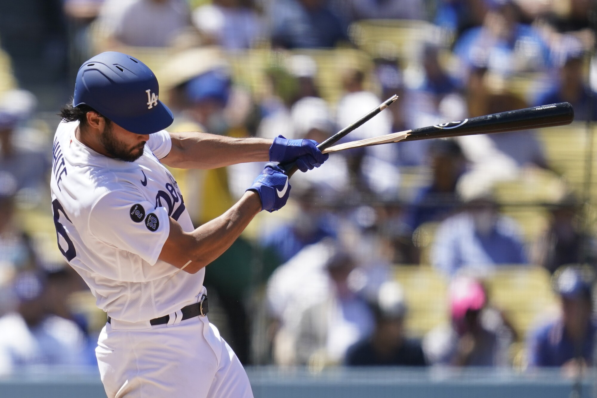 Los Angeles Dodgers' Mitch White breaks a bat as he grounds out during the third inning.