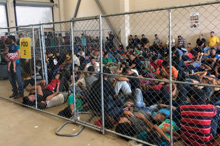 migrant families overcrowding in border patrol station