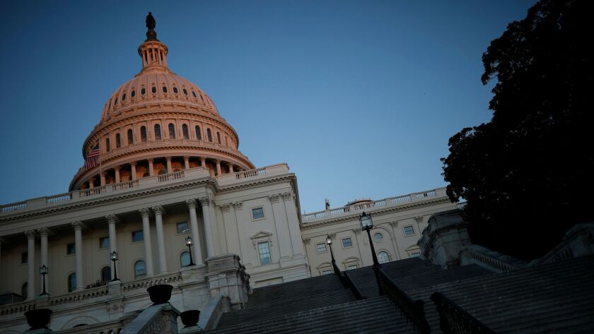 The U.S. Capitol is seen as lawmakers work to avert a government shutdown on Jan. 19. in Washington, DC.