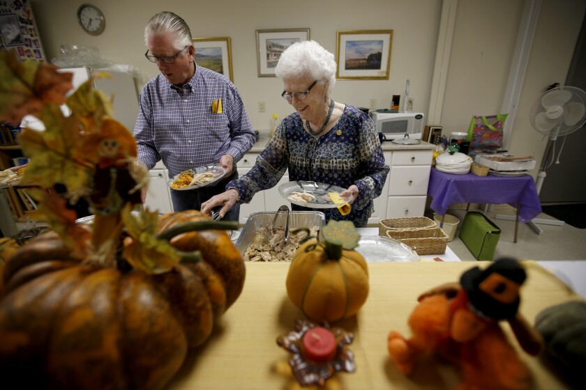 Edna Ivans, right, an 88-year-old resident of Avenal, partakes in the Rotary Club's potluck in November.
