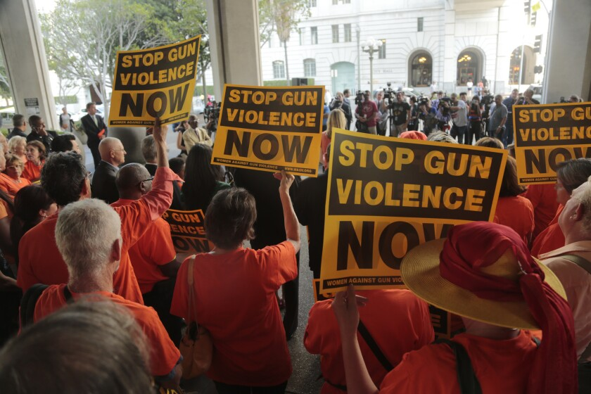 Gun control advocates gather at Los Angeles City Hall on July 28 before a vote by the Los Angeles City Council that bans possession of large-capacity firearm magazines.