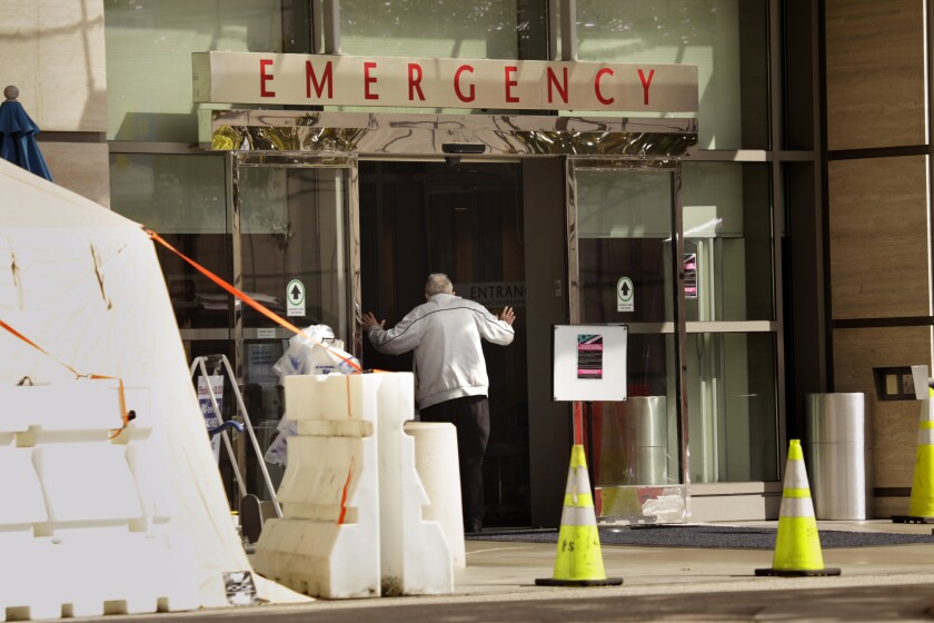 A man enters the emergency room at Ronald Reagan UCLA Medical Center last month.