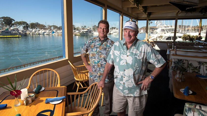 General manager Jay Styles, left, and owner Robert Mardian at the Wind and Sea restaurant in Dana Point, which is celebrating its 45th anniversary. Mardian opened the restaurant after realizing he didn't want to become a lawyer.