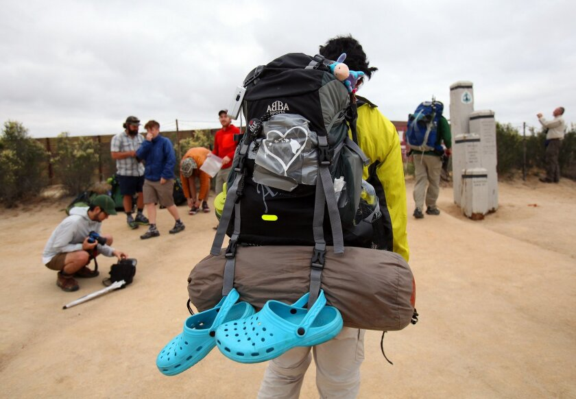 """Registering for the 2,650-mile hike in Campo. """"Bit of a conga line,"""" one organizer said."""