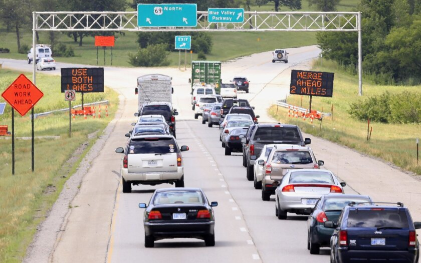 Drivers head north on U.S. 69 into a construction zone in Overland Park, Kan., Thursday, July 7, 2016. Kansas and Missouri departments of transportation hope to manage heavy construction seasons by persuading polite midwesterners to do the zipper merge. Rather than merging as soon as it's safe, dri