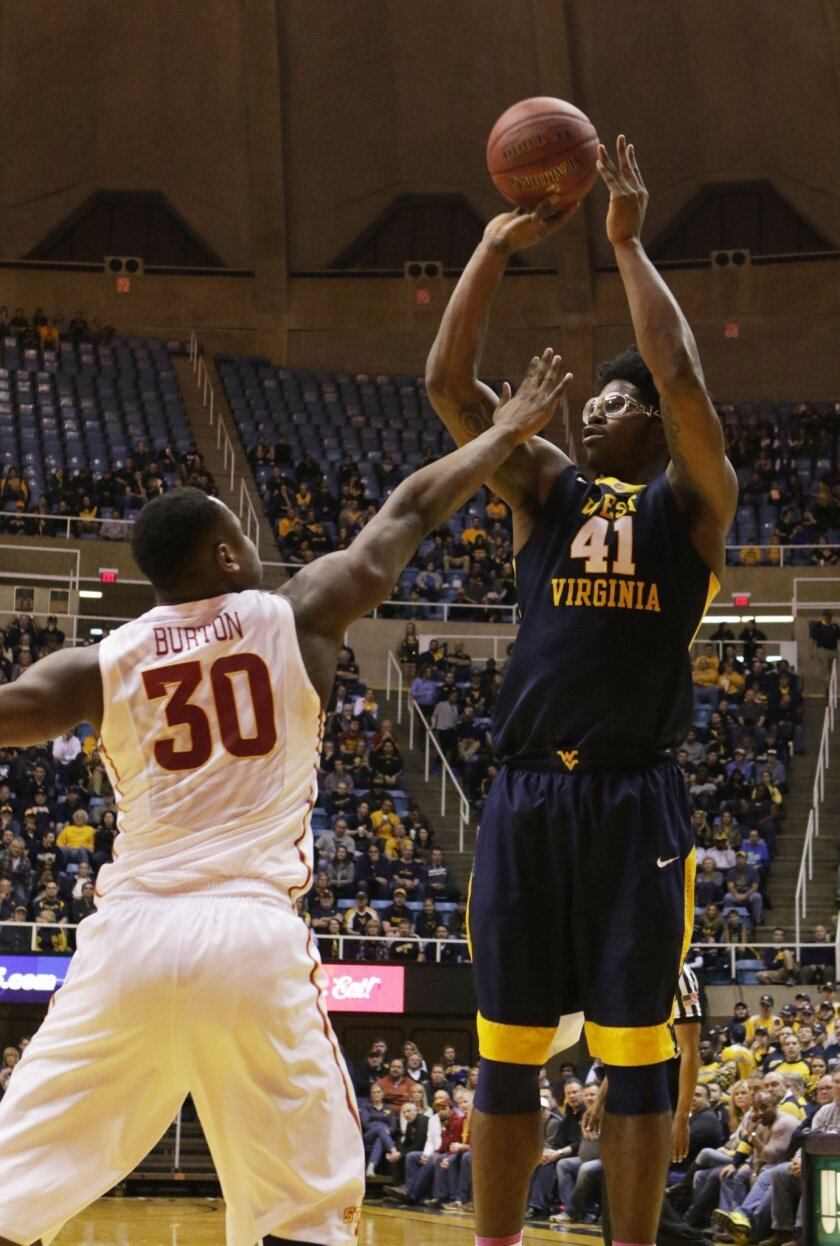 West Virginia forward Devin Williams (41) takes a shot over Iowa State guard Deonte Burton (30) during the second half of an NCAA college basketball game, Monday, Feb, 22, 2016, in Morgantown, W.Va. (AP Photo/Raymond Thompson)