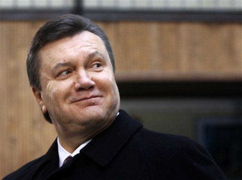 Ukrainian opposition leader and presidential candidate Viktor Yanukovych is seen at a polling station during the presidential election in Kiev, Ukraine Sunday, Feb. 7, 2010. (AP Photo/Efrem Lukatsky)