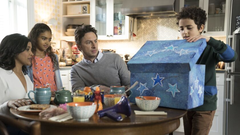 """Tiya Sircar, left, Audyssie James, Zach Braff and Elisha Henig are a family whose father is starting a podcast in the ABC comedy """"Alex, Inc."""""""