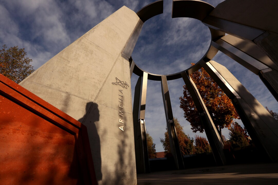 A shadow is cast against the Armenian Genocide Centennial Memorial on the campus of California State University Fresno