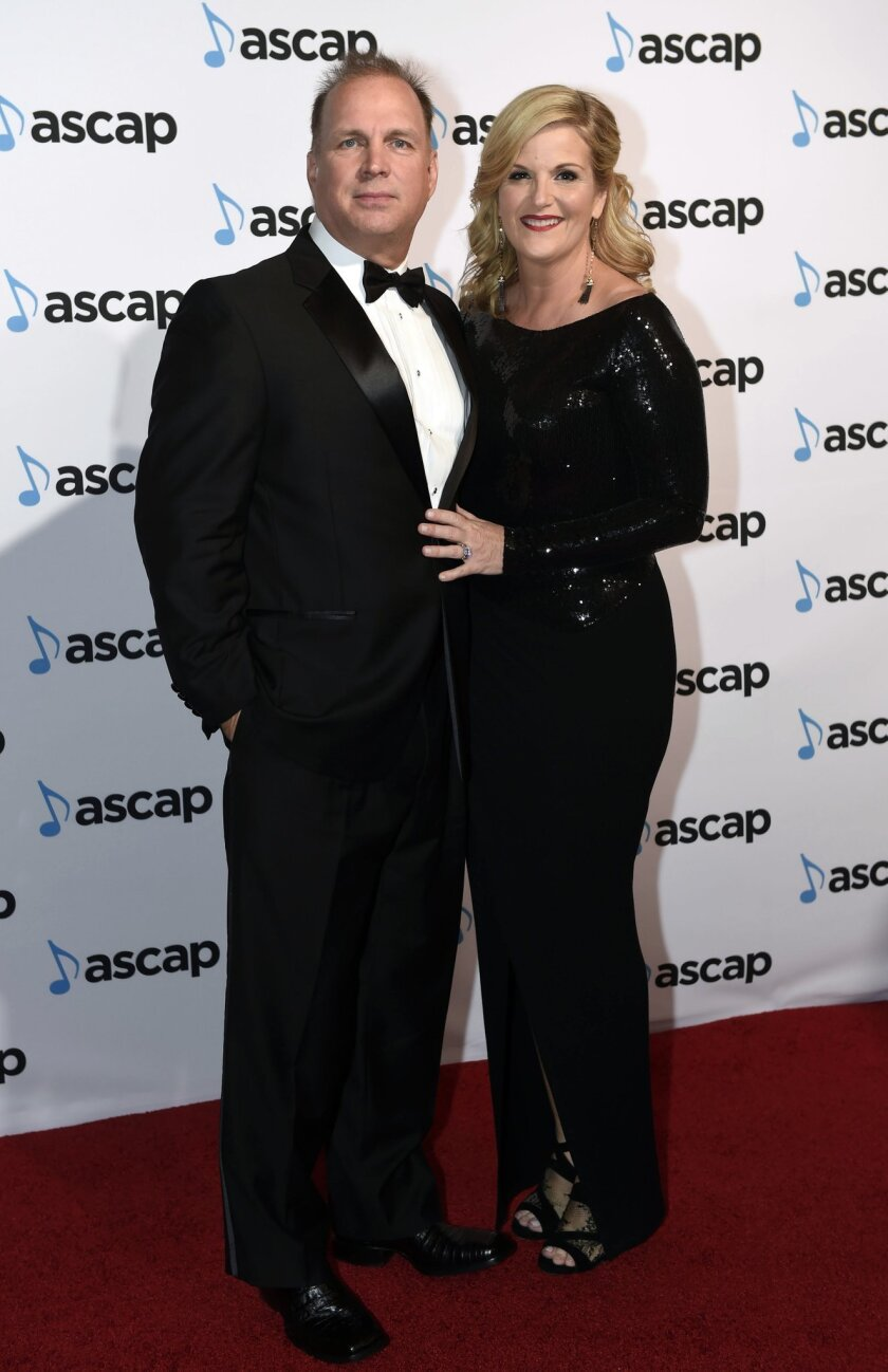 Garth Brooks, left, and Trisha Yearwood arrive at the 53rd Annual ASCAP Country Music Awards at the Omni Hotel on Monday, Nov. 2, 2015 in Nashville, Tenn. (Photo by Sanford Myers/Invision/AP)