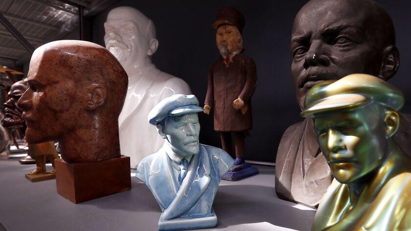 Busts of Lenin line a shelf.