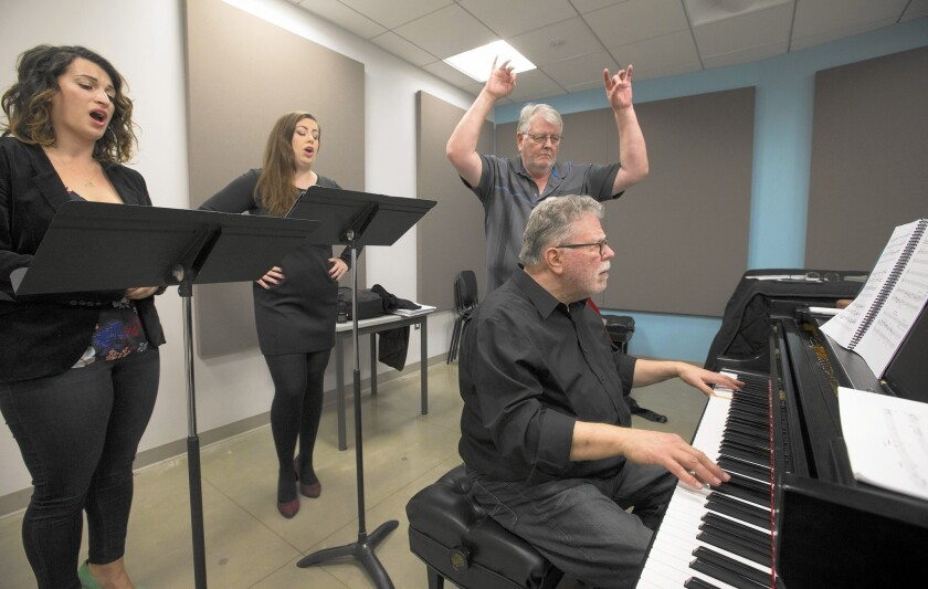 Neely Bruce, playing piano, and Don Brinegar rehearse with L.A. Opera sopranos Katherine Giaquinto, left, and Marina Harris.