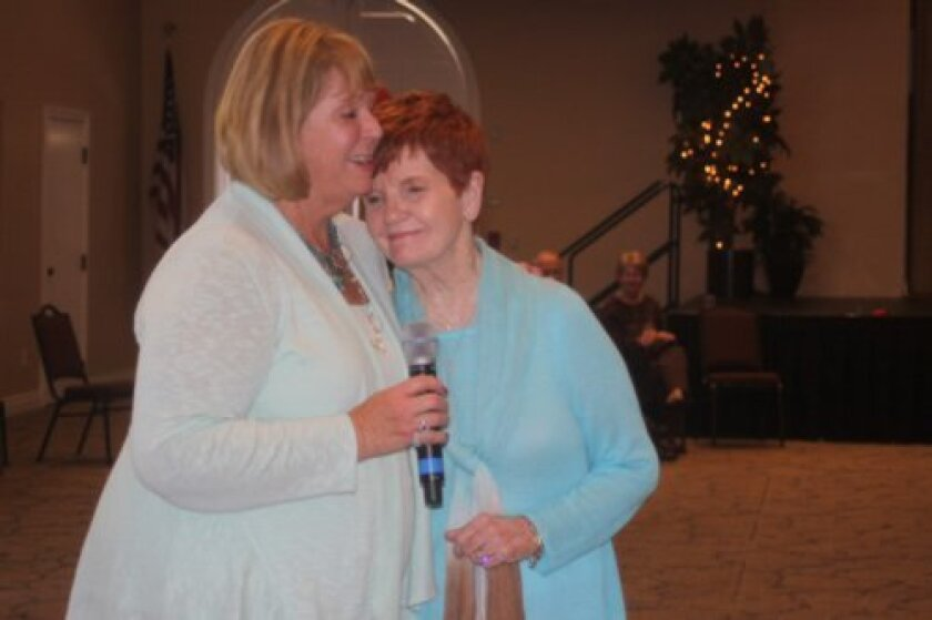 Mary Lynn Carroll is one of many to say a few words about Betty Hilbert (right).