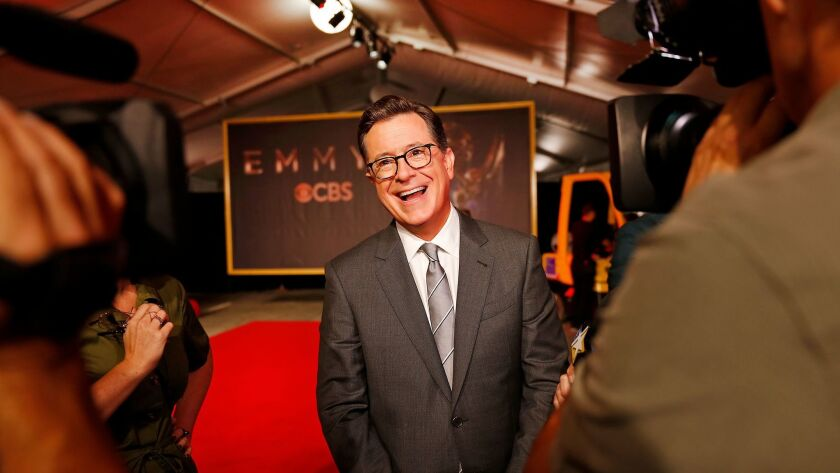 Emmy Awards telecast host Stephen Colbert talks to media following the official red carpet rollout f
